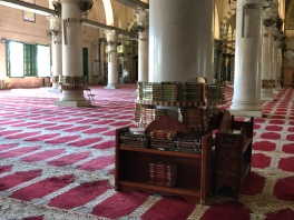 Books with carpet with prayer space