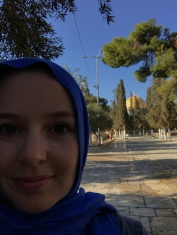 I was required to follow a modest dress code-long skirt, long sleeves, and a head scarf. We were also not allowed to touch each other with on the Al-Aqsa space. This is the first glimpse of the dome.