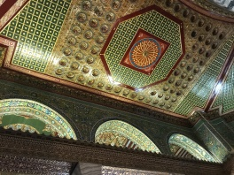 The mosaics on the arches and ceiling are predominately green and gold representing God's creation.