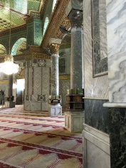 The interior is stunning!!! It is an octagonal building with red, green, and while marble columns.