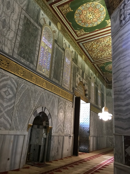 When it is time to pray, the imam leads from the niche which faces Mecca. The carpet is designed with space for each man to pray. Women are not allowed to pray inside. ~ Mosaic stained glass windows surround the top of the octagonal walls, allowing light in, but keeping the heat out.